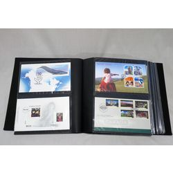blue fdc album and slipcase with 54 different official canada post first day covers from march 1997 to october 2010