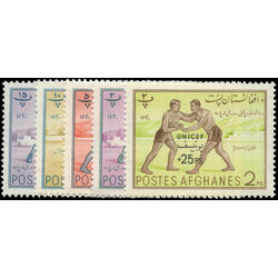 afghanistan stamp b37 41 afghan fencing wrestlers and man with indian clubs 1961