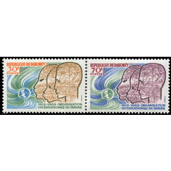 dahomey stamp 257 8 heads symbols of agriculture and science and globe 1969